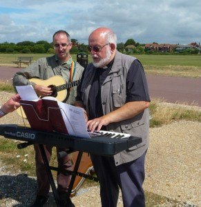 Associate Priest, Rev Phil Hiscock playing keyboard on the beach - also chaplain to the port!