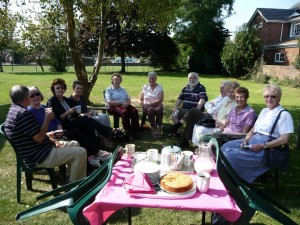Cuppa & Company enjoying tea in the Parish Centre Garden!